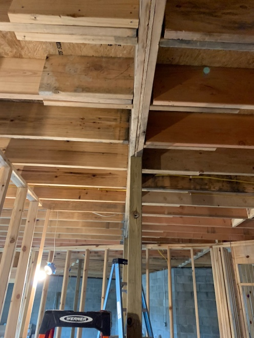 The pieces of wood attached to the joist are called scabs