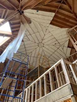 Spray foam insulation begins