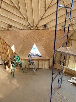 Plywood walls at living room window