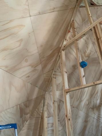 Plywood walls at second floor bedroom