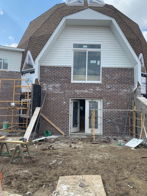East side of the house with finished brick