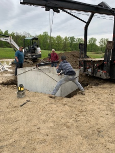 Lowering the septic tank into place