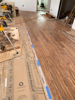 Wood flooring in the living/dining room.