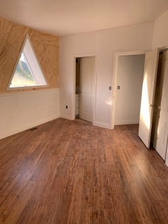 Master bedroom with flooring and trim complete