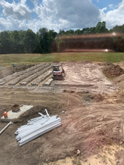 Halfway done with the pipe layout in the field